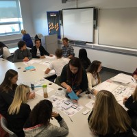 | Students playing the budgeting game at Anglia Ruskin University Roadshow